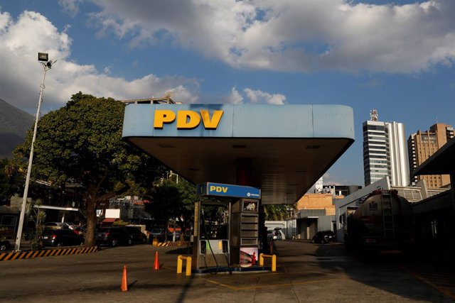 The corporate logo of the Venezuelan oil company PDVSA is seen at a gas station