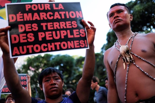 Indigenous men take part in a protest against Brazilian President Jair Bolsonaro