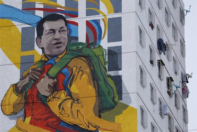 A giant mural depicting late Venezuelan President Hugo Chavez is seen on a build
