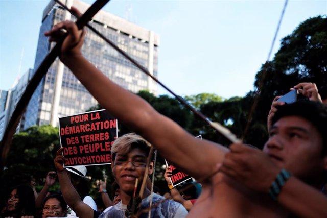 Indigenous men take part in a protest against Brazil President Jair Bolsonaro's