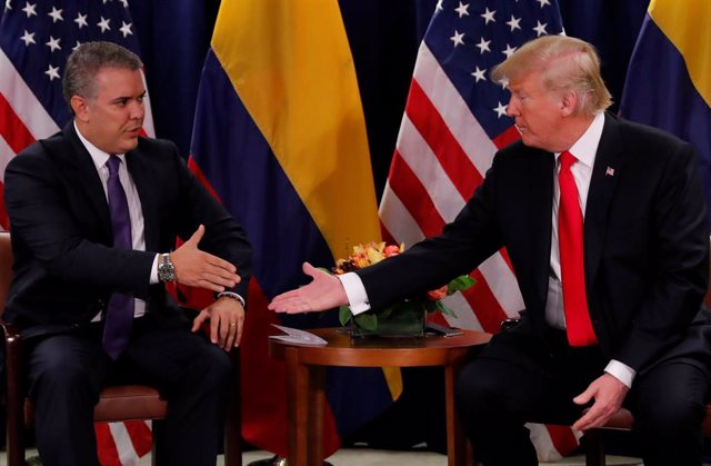 U.S. President Donald Trump is greeted by  Colombia's President Ivan Duque durin
