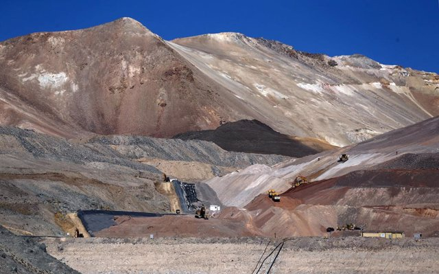 Dump trucks and bulldozers operate at Barrick Gold Corp's Veladero gold mine in