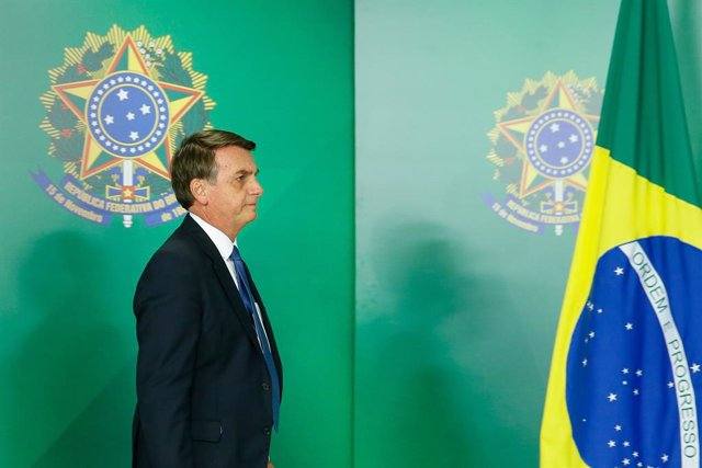 Brazil's President Jair Bolsonaro arrives to gives a statement at the Planalto P