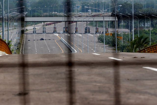Barricades of tires block the vehicular passage at the Tienditas cross-border br