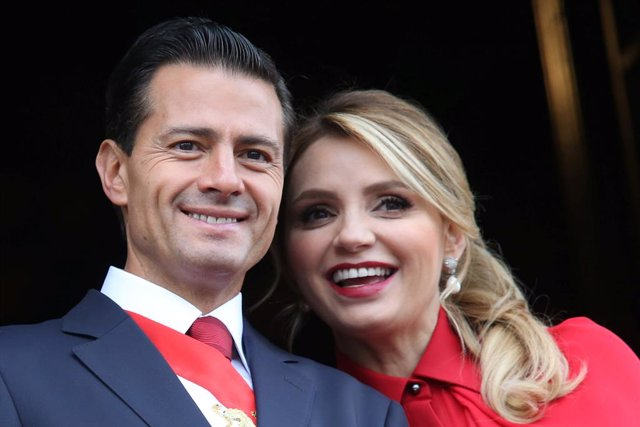 Mexico's President Enrique Pena Nieto smiles with First Lady Angelica Rivera dur