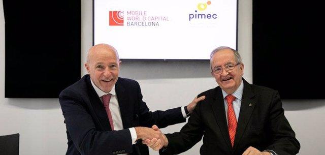 El conseller delegat de MWCapital, Carlos Grau, i el president de Pimec, Josep G