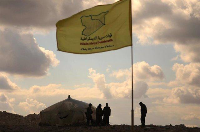 Miembros de las Fuerzas Democráticas Sirias (FDS) en Baghuz, en el este de Siria