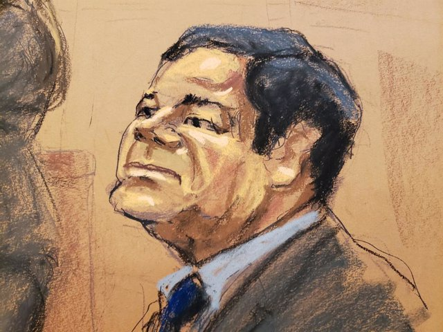 "Accused Mexican drug lord Joaquin ""El Chapo"" Guzman sits in court in this courtr"