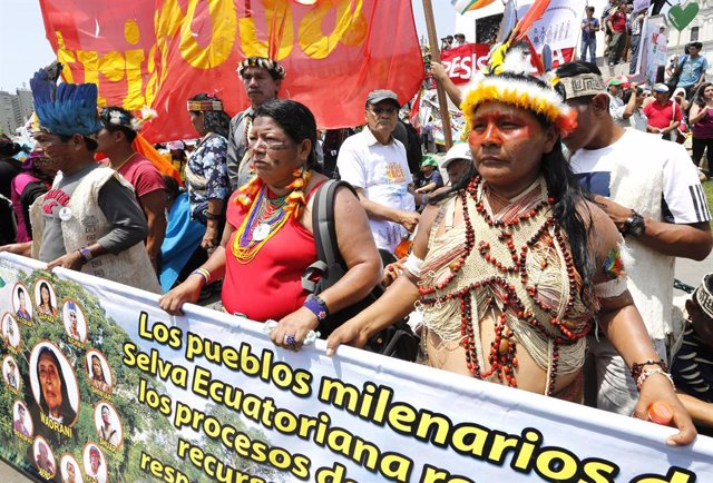 "Ecuadorean indigenous environmental activists march at the ""People's Climate Mar"