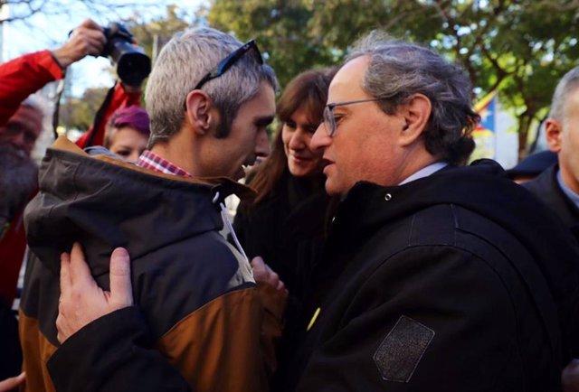 El presidente Quim Torra con Roger Español