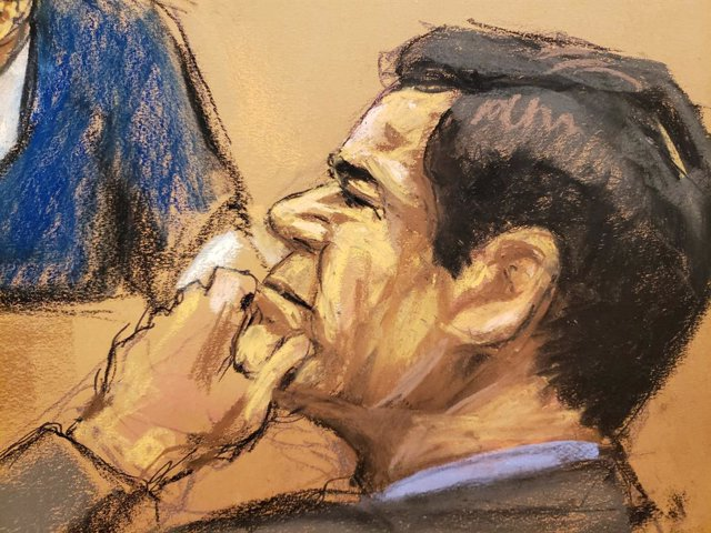 "The accused Mexican drug lord Joaquin ""El Chapo"" Guzman listens to a testimony b"