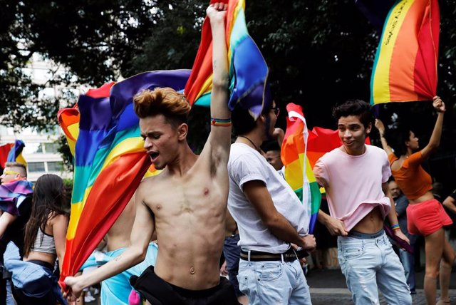 Revellers dance as they take part in the Gay Pride parade along Paulista Avenue