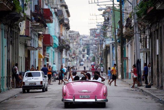 Tourists ride a vintage car in Havana, Cuba, June 11, 2018. REUTERS/Alexandre Me