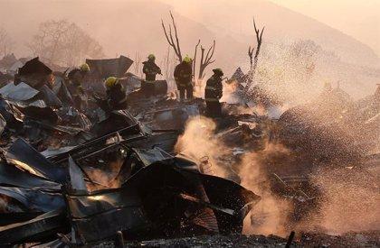 Un incendio en la capital de Chile obliga a las autoridades a evacuar el zoológico de la ciudad