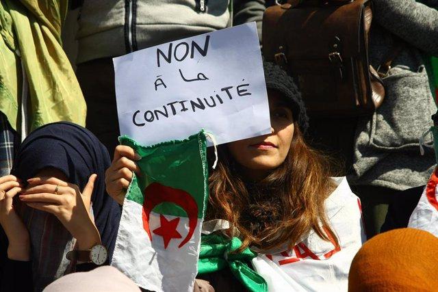 Algerians protest election postponement