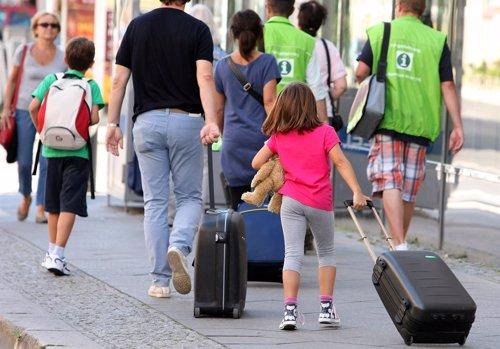 Viajar en familia/GETTY