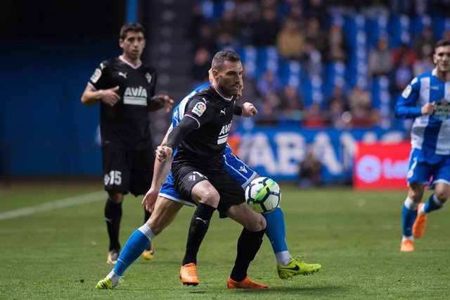 Arbilla of Eibar and Andone of Deportivo in action during Santander League (La L