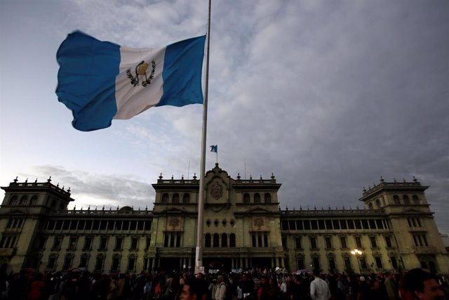 The Guatemalan flag flies at half-staff during a protest to demand justice for t