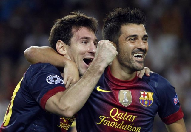 Messi y Villa celebran el tercer gol ante el Spartak