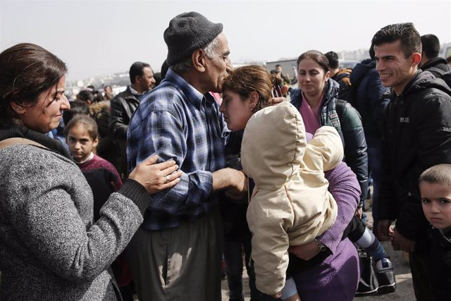 A Syrian refugee from the town of Deir al-Zor reunites with members of his famil