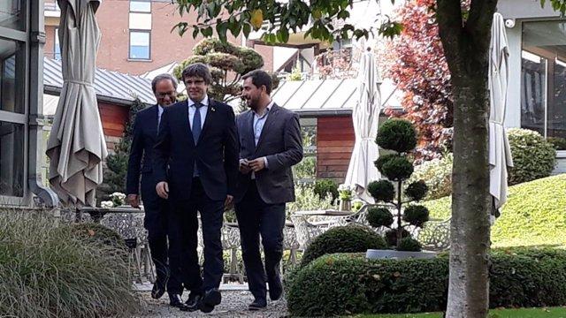 El presidente Quim Torra, el expresidente Carles Puigdemont y Toni Comín