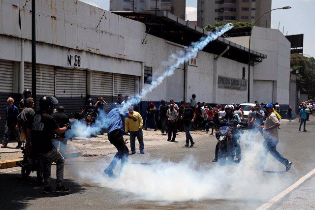 Venezuela.- Decenas de heridos y al menos once detenidos por la marcha por Caracas liderada por Guaidó y López
