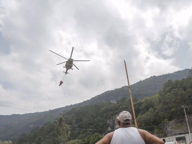 Al menos cinco muertos tras desplomarse un helicóptero de la Marina mexicana cuando combatía un incendio en Querétaro