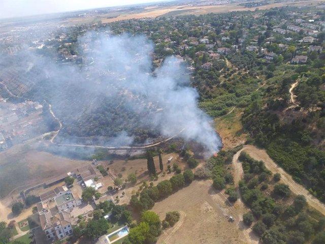 Sevilla.- Sucesos.- Controlado el incendio de Gelves, donde los efectivos continúan con las labores de refresco