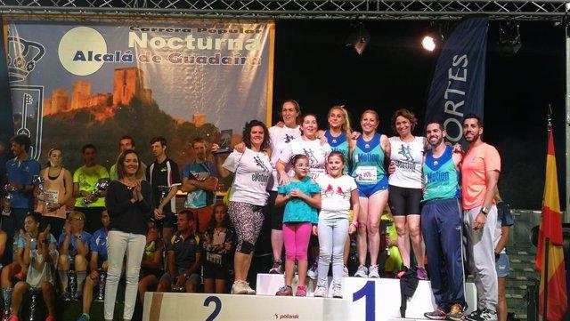 Sevilla.- Un millar de atletas participan en la carrera popular nocturna de Alcalá de Guadaíra