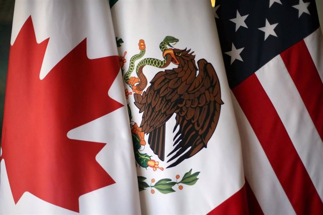 FILE PHOTO: Flags are pictured during NAFTA talks involving the United States, M