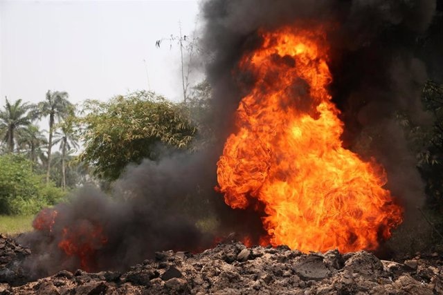 Fire burns on the Shell Petroleum Development Company Trans Niger pipeline at Mogho