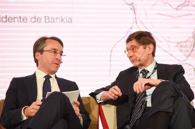 Hector Florez, socio director de consultoria de Deloitte y Jose Ignacio Goirigolzarri, presidente de Bankia