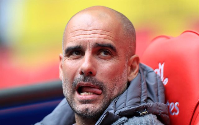 18 May 2019, England, London: Manchester City manager Pep Guardiola is pictured prior to the English FA Cup Final soccer match between Manchester City and Watford at Wembley Stadium. Photo: Mike Egerton/PA Wire/dpa