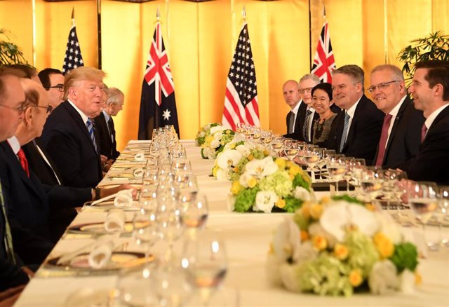 27 June 2019, Japan, Osaka: Australian Prime Minister Scott Morrison (2-R) meets with US President Donald Trump (4-L), ahead of the official start of the G20 summit, which to take place on 28 and 29 June 2019. Photo: Lukas Coch/AAP/dpa