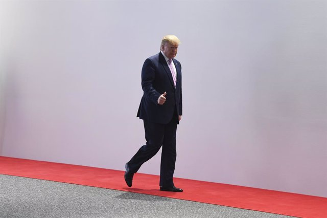 28 June 2019, Japan, Osaka: US President Donald Trump leaves after the welcoming ceremony of the G20 summit. Photo: Lukas Coch/AAP/dpa