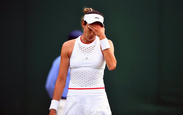 02 July 2019, England, London: Spanish tennis player Garbine Muguruza reacts in frustration during her women's singles round of 128 match against Brazil's Pauline Parmentier on day two of the 2019 Wimbledon Grand Slam tennis tournament at the All England