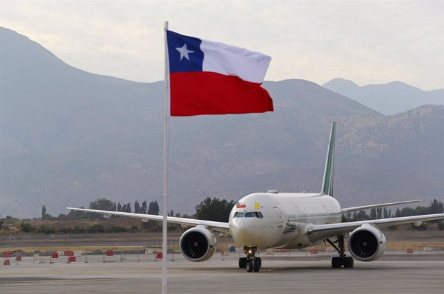 The flag of Chile flutters as a plane transporting Pope Francis prepares to park after his arrival in Santiago