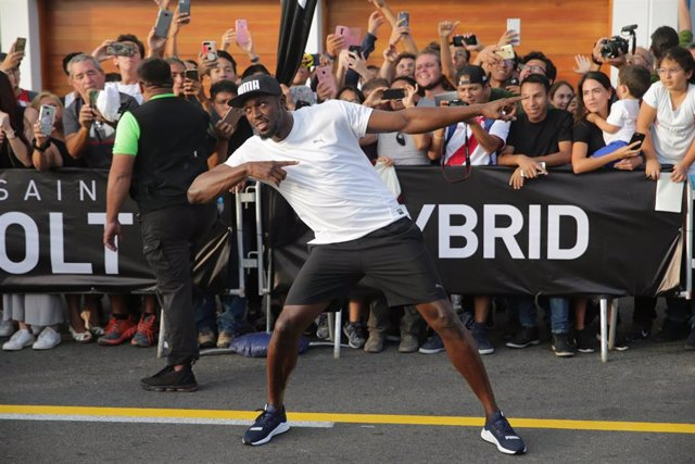 02 April 2019, Peru, Lima: Jamaican retired sprinter Usain Bolt celebrates after winning a race against a motorcycle taxi during an event as part of a tour in Peru. Photo: El Comercio/GDA via ZUMA Wire/dpa