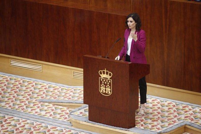 La candidata del PP a la presidencia de la Comunidad de Madrid, Isabel Díaz Ayuso, durante su intervención en el pleno de investidura del presidente de la Comunidad de Madrid.