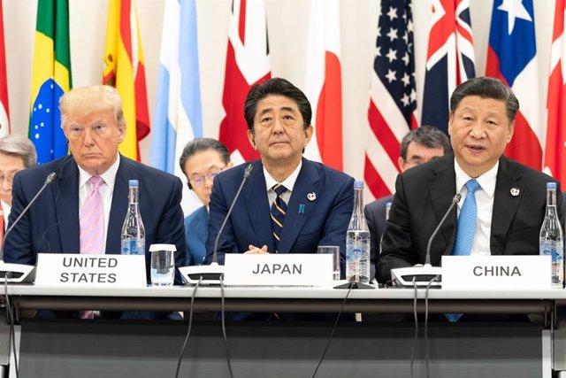 Donald Trump junto a Shinzo Abe y Xi Jinping en la cumbre del G20 en Osaka (Japón)