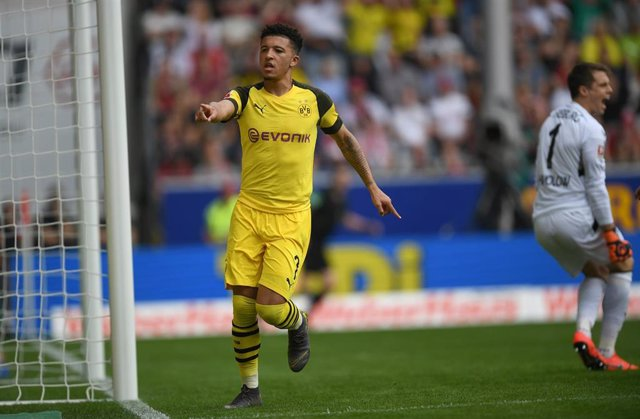 21 April 2019, Baden-Wuerttemberg, Freiburg: Dortmund's Jadon Sancho celebrates scoring during the German Bundesliga soccer match between SC Freiburg and Borussia Dortmund at the Schwarzwald Stadion. Photo: Patrick Seeger/dpa - WICHTIGER HINWEIS: Gemä de