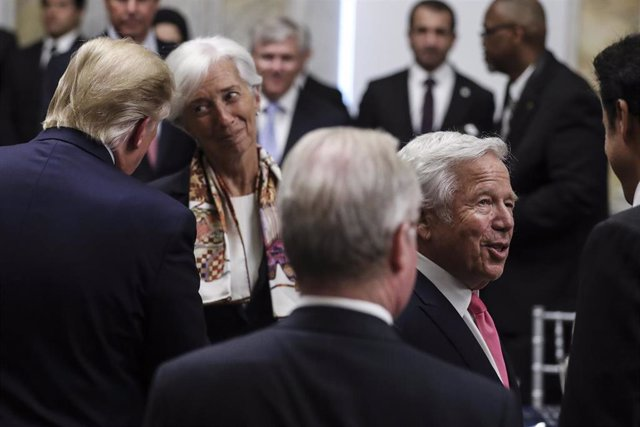 July 8, 2019 - Washington, DC, United States: President Donald Trump, left, talks to International Monetary Fund Managing Director Christine Lagarde, second left, next to the owner of the New England Patriots Robert Kraft, second from the right, and Qatar
