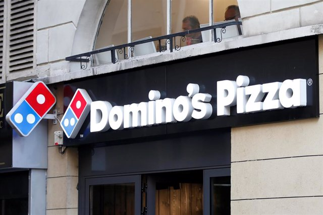 The sign of a Domino's Pizza restaurant is seen in Paris