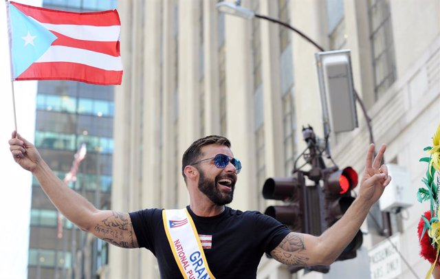 June 9, 2019, New York, New York, USA. Ricky Martin dances on his float as he continues up Fifth Avenue during the Puerto Rican Day Parade. He is the Grand Marshall at the Puerto Rican Day Parade (Andrea Renault / Contacto Images)