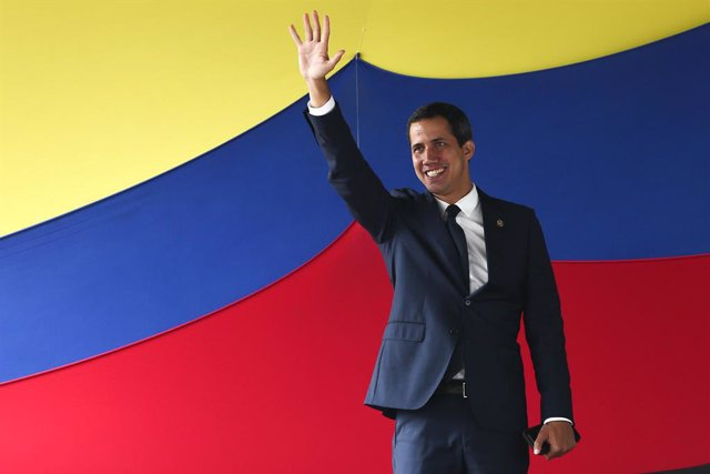 23 July 2019, Venezuela, Caracas: Opposition leader and self-proclaimed interim president of Venezuela Juan Guaido waves to supporters as he arrives at a rally in Caracas. Photo: Pedro Mattey/dpa