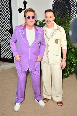 24 July 2019, France, Antibes: British singer Elton John (L)and his partner David Furnish attends the Elton John Aids foundation Midsummer Party at Jean Pigozzi's Villa Dorane. Photo: Matt Crossick/PA Wire/dpa