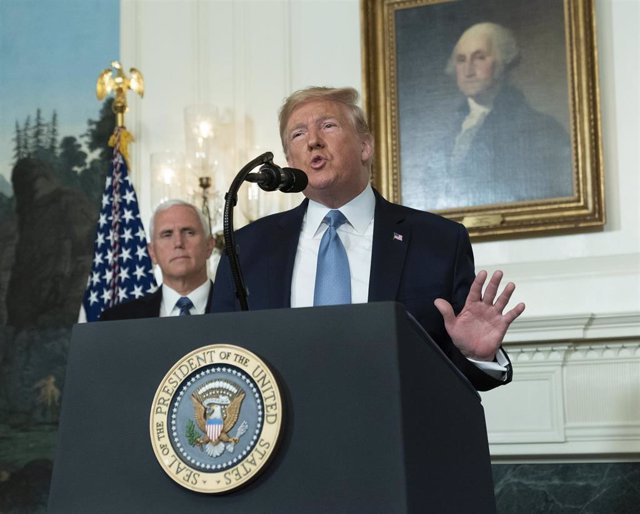 August 5, 2019 - Washington, DC, United States: United States President Donald J. Trump makes a statement at the White House in Washington, DC in response to two separate shooting incidents, August 5, 2019. United States Vice President Mike Pence listens.