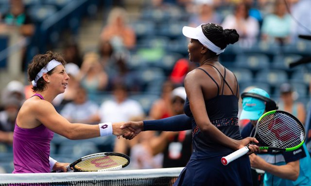 Carla Suarez Navarro of Spain & Venus Williams of the United States in action during the first round at the 2019 Rogers Cup WTA Premier Tennis 5 Tournament
