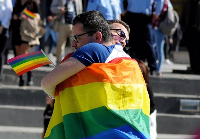 People hug during the second LGBT Pride Parade in Pristina