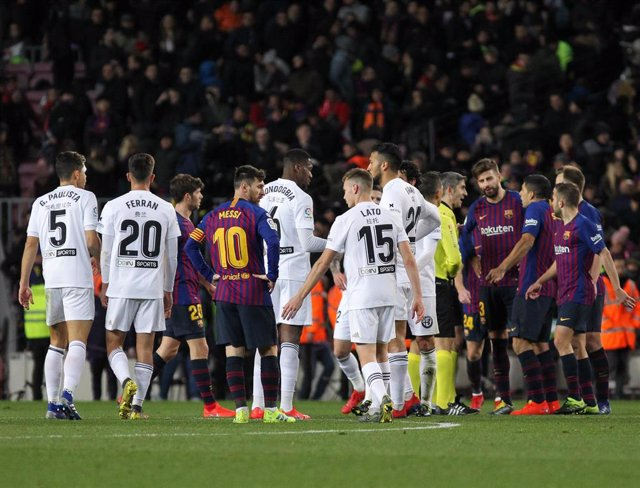 Players of Barcelona and Valencia in action during La Liga Spanish championship, , football match between Barcelona and Valencia, February 02th, in Camp Nou Stadium in Barcelona, Spain.